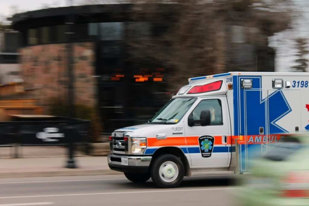ambulance rushing to pick up a patient who has suffered alcohol poisoning